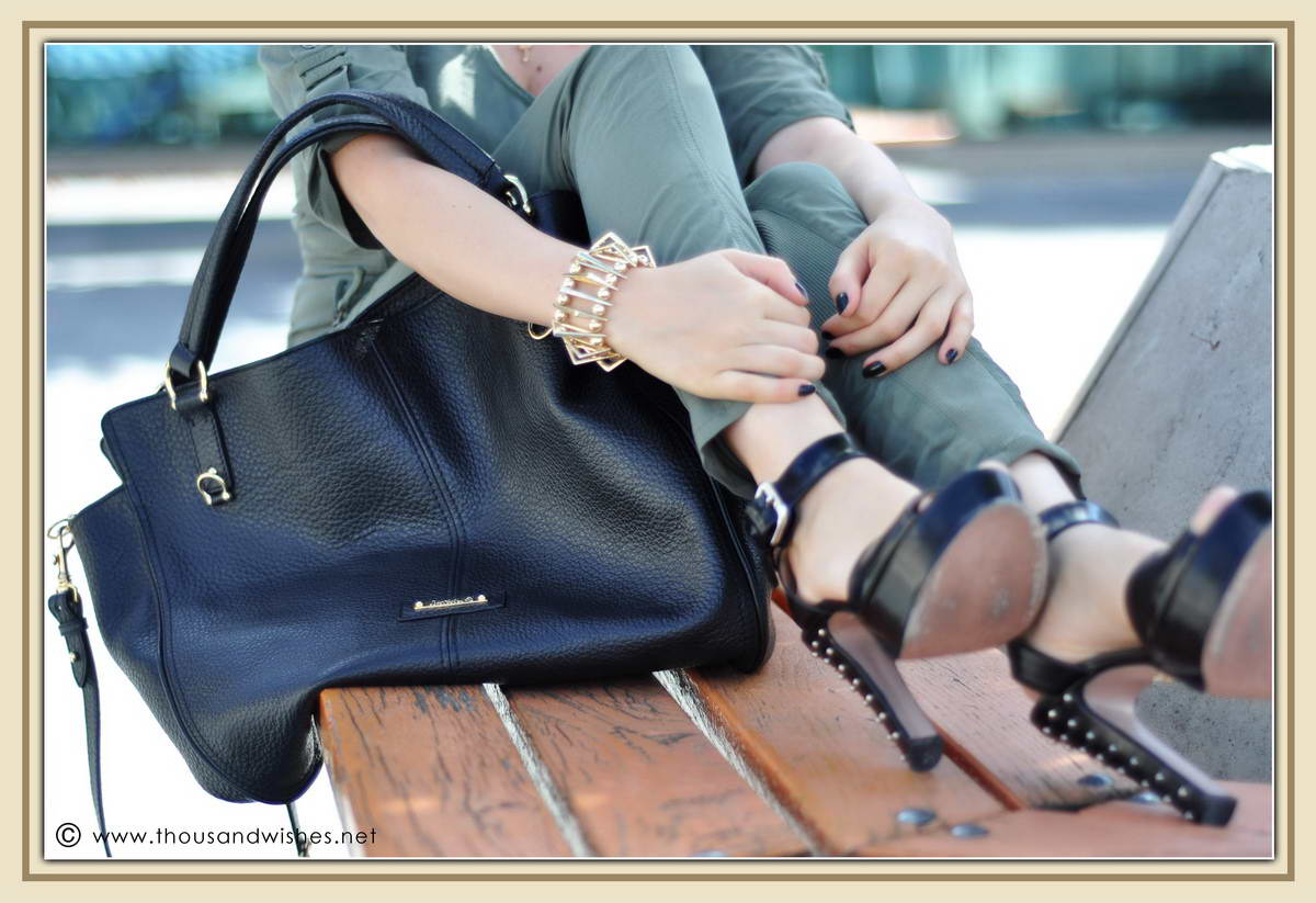 11_khaki_jumper_black_studded_heels_bag