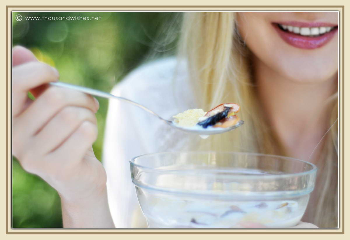 26_blonde_eating_breakfast_dried_fruits_cereals